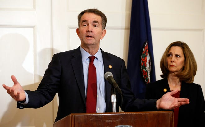 In this Feb. 2, 2019, photo, Virginia Gov. Ralph Northam, left, accompanied by his wife, Pam, speaks during a news conference in the governor's mansion in Richmond, Va.