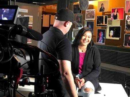 Daphne Martinez is being prepared to be filmed by the video production company that was hired by the PGA tour.