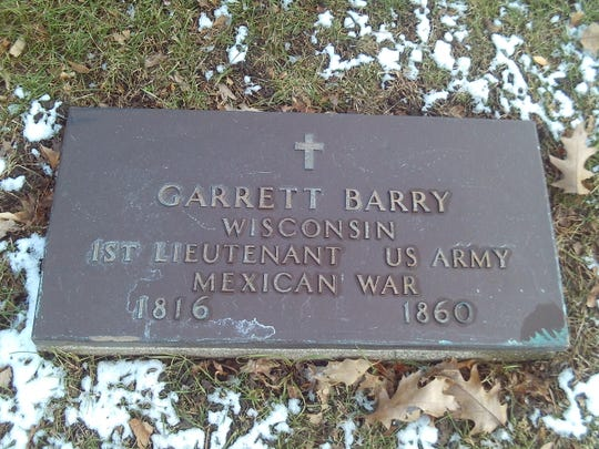 Garrett's Barry's grave. Barry was a union guard in the the Third Ward and led the effort to organize the fundraiser where passengers could ride the Lady Elgin from Milwaukee to Chicago and back.