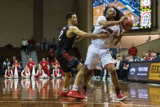 USD's Brandon Armstrong (20) looks to pass the ball during a game against Omaha at the Sanford Pentagon in Sioux Falls, S.D., Thursday, Feb. 7, 2019.