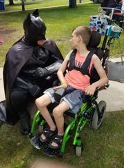 Terry Mattke, dressed as Batman, is expanding his charitable work as the Caped Crusader.