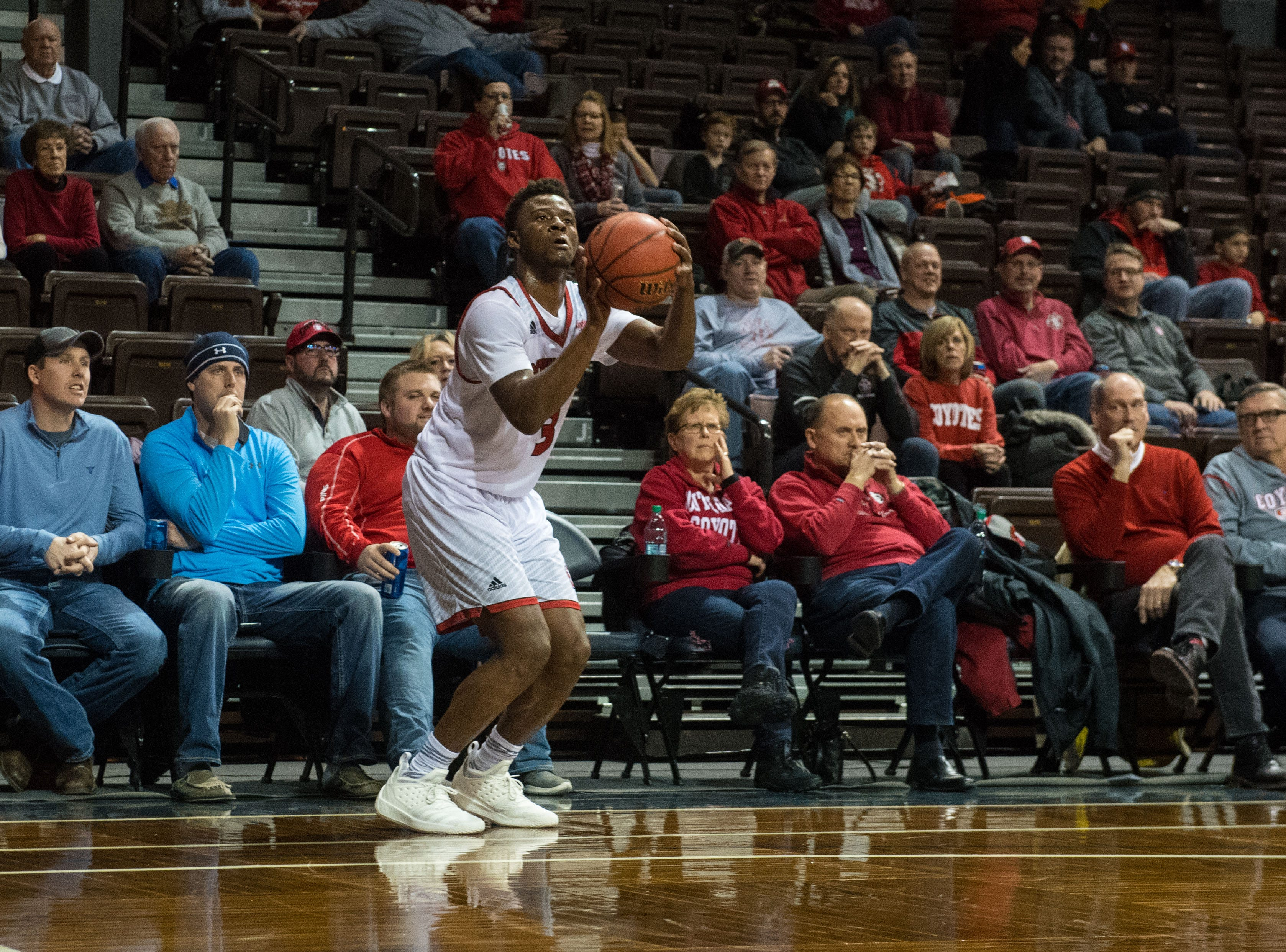 USD's Triston Simpson (3) shoots the ball during a game against Omaha at the Sanford Pentagon in Sioux Falls, S.D., Thursday, Feb. 7, 2019.