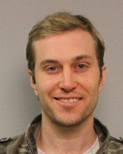 A 2013 mug shot of Chris Sevier, who heads the group behind the failed effort to block porn on South Dakota personal devices. Sevier's mug shot was taken from a stalking arrest after he sent country music star John Rich threatening emails, according to police reports.