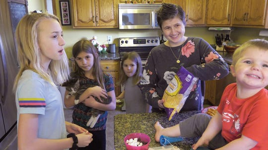 Kristin VanLaecken enjoys time at home in Watertown, S.D., with four of her children. From left to right: Maia, Sophia, Ella, Kristin and Luke. Family has been a major support system for Kristin during her treatment.