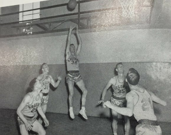 Delbert Gillam takes a shot in the tiny gym at Argonne High School, which closed several years after Gillam set the state scoring record.