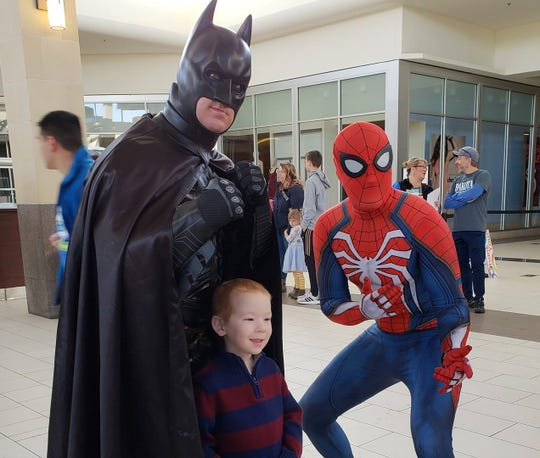Terry Mattke, Sioux Falls' own Batman, is joined by fellow superhero Spiderman at LifeScape's MallWalk 2019.