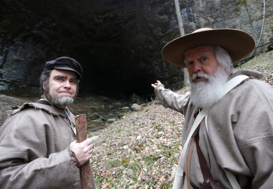 Smallin Civil War Cave historian Eric Fuller, left, during a recent visit by Rick Mansfield, who retraced Henry Schoolcraft's 900-mile trek through the Ozarks.