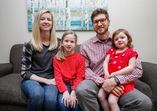 Rocky and Breanna Valentine with their daughters Lyla, 7, and Lily, 3. Rocky and Lyla both received heart transplants and help raise awareness for heart disease with their story.
