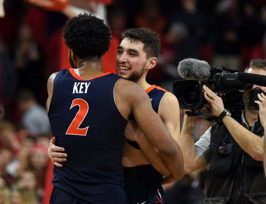 Virginia Cavaliers guard Braxton Key (2) and Cavaliers guard Ty Jerome (11) celebrate after defeating the North Carolina State Wolfpack at PNC Arena.
