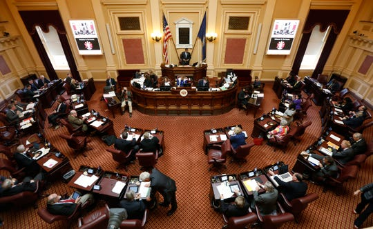 Virginia Lt. Gov. Justin Fairfax, on Dias, welcomes Senators as the start of the Senate session at the Capitol in Richmond, Va., Friday, Feb. 8, 2019.