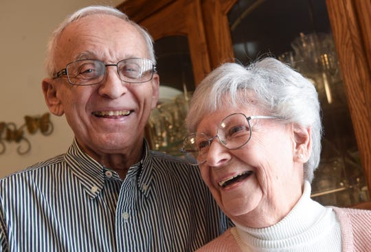 Marcel Tadych and Doree Canfield smile while talking about their lives together  during an interview Thursday, Feb. 7, at their home in Sartell.