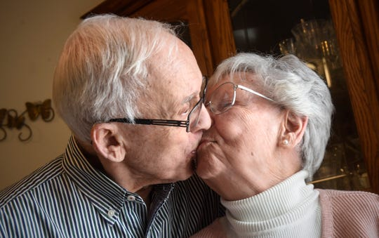 Marcel Tadych and Doree Canfield share a kiss Thursday, Feb. 7, at their home in Sartell.