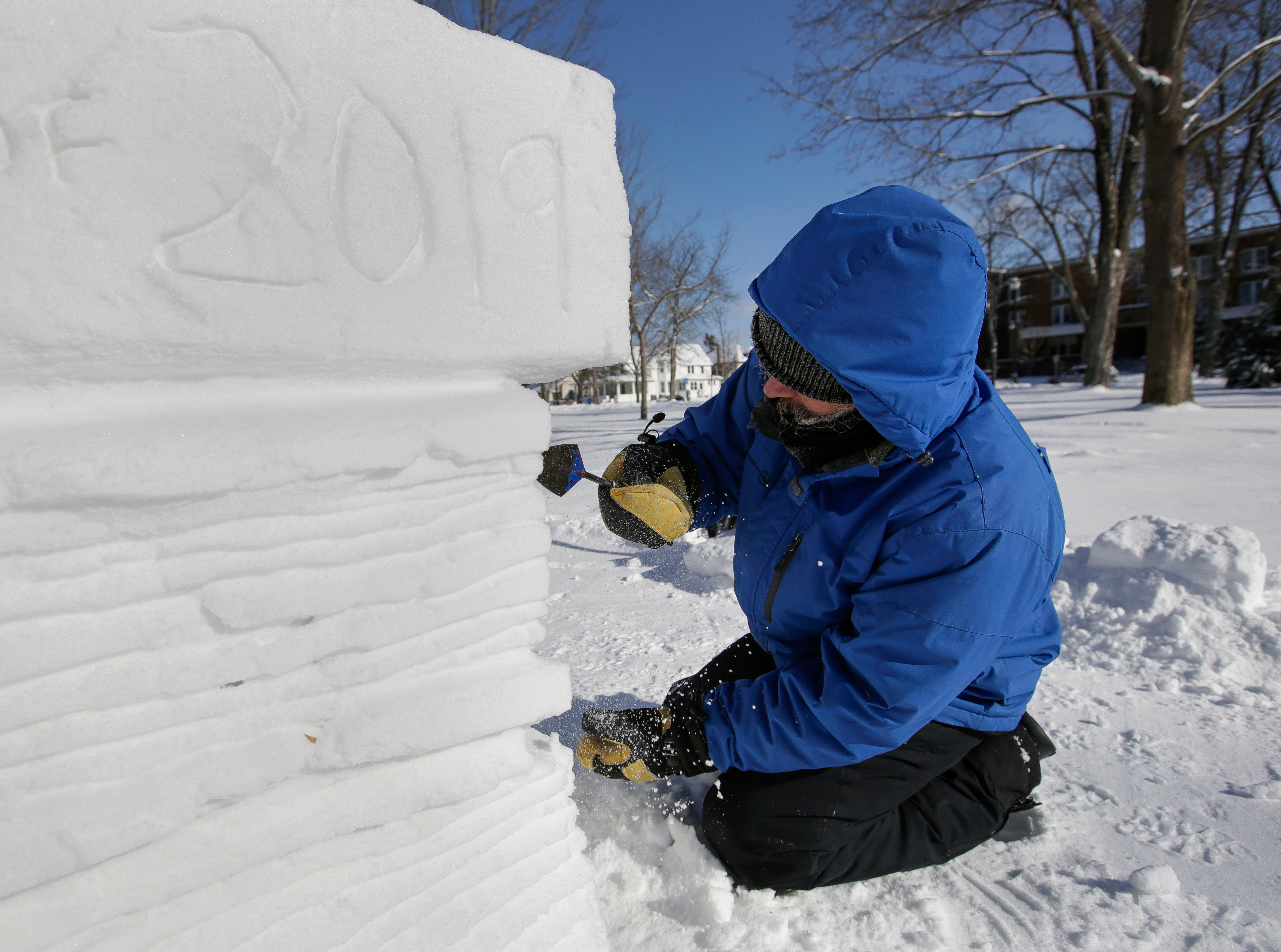 Local artist Jef Schobert carves out details on a sculpture on Friday, February 8, 2019, on the UWSP campus in Stevens Point, Wis. The sculpture is to commemorate UWSP's 125th anniversary.Tork Mason/USA TODAY NETWORK-Wisconsin