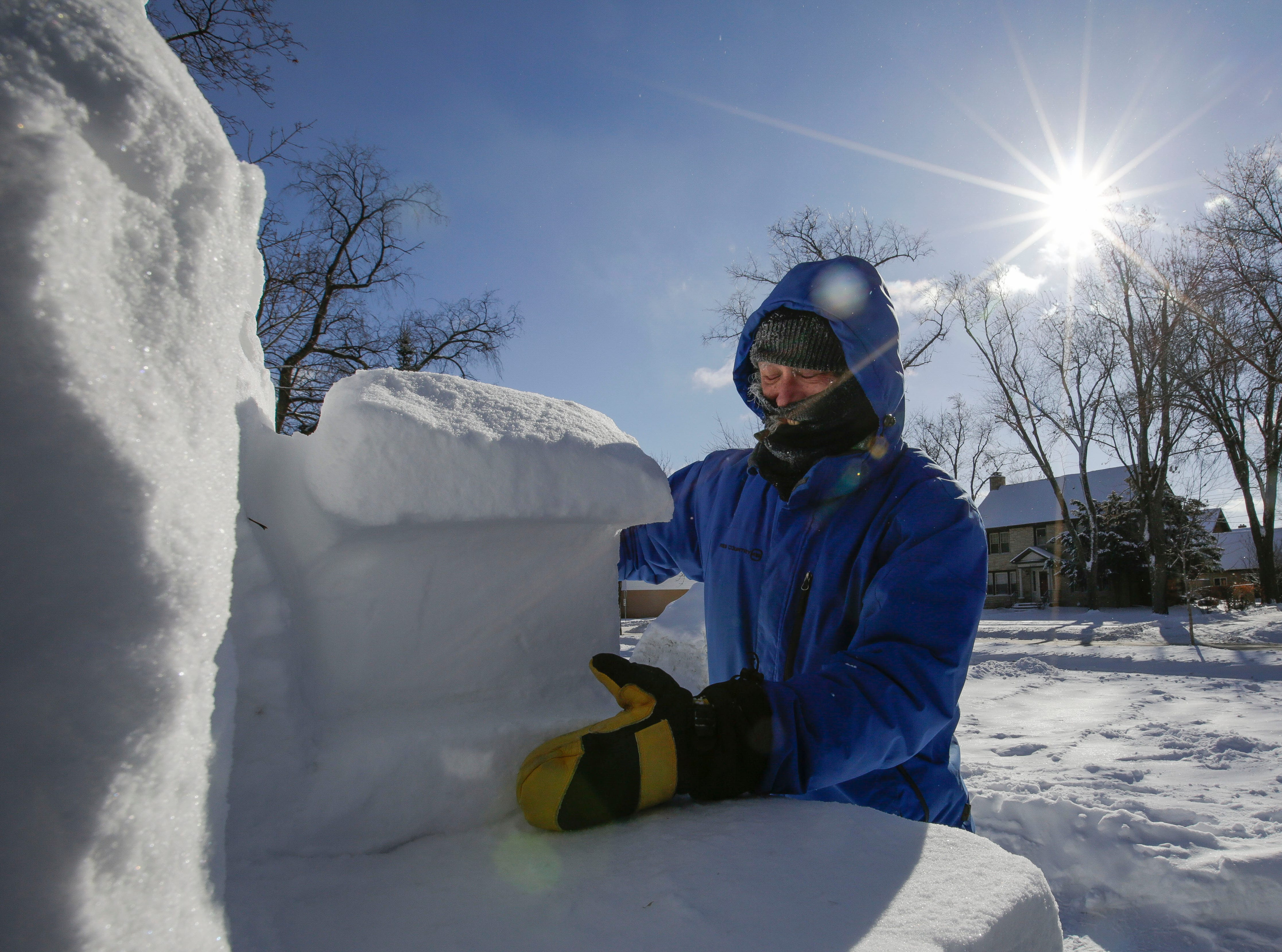 Local artist Jef Schobert brushes loose snow off of his sculpture on Friday, February 8, 2019, on the UWSP campus in Stevens Point, Wis. The sculpture is to commemorate UWSP's 125th anniversary.Tork Mason/USA TODAY NETWORK-Wisconsin
