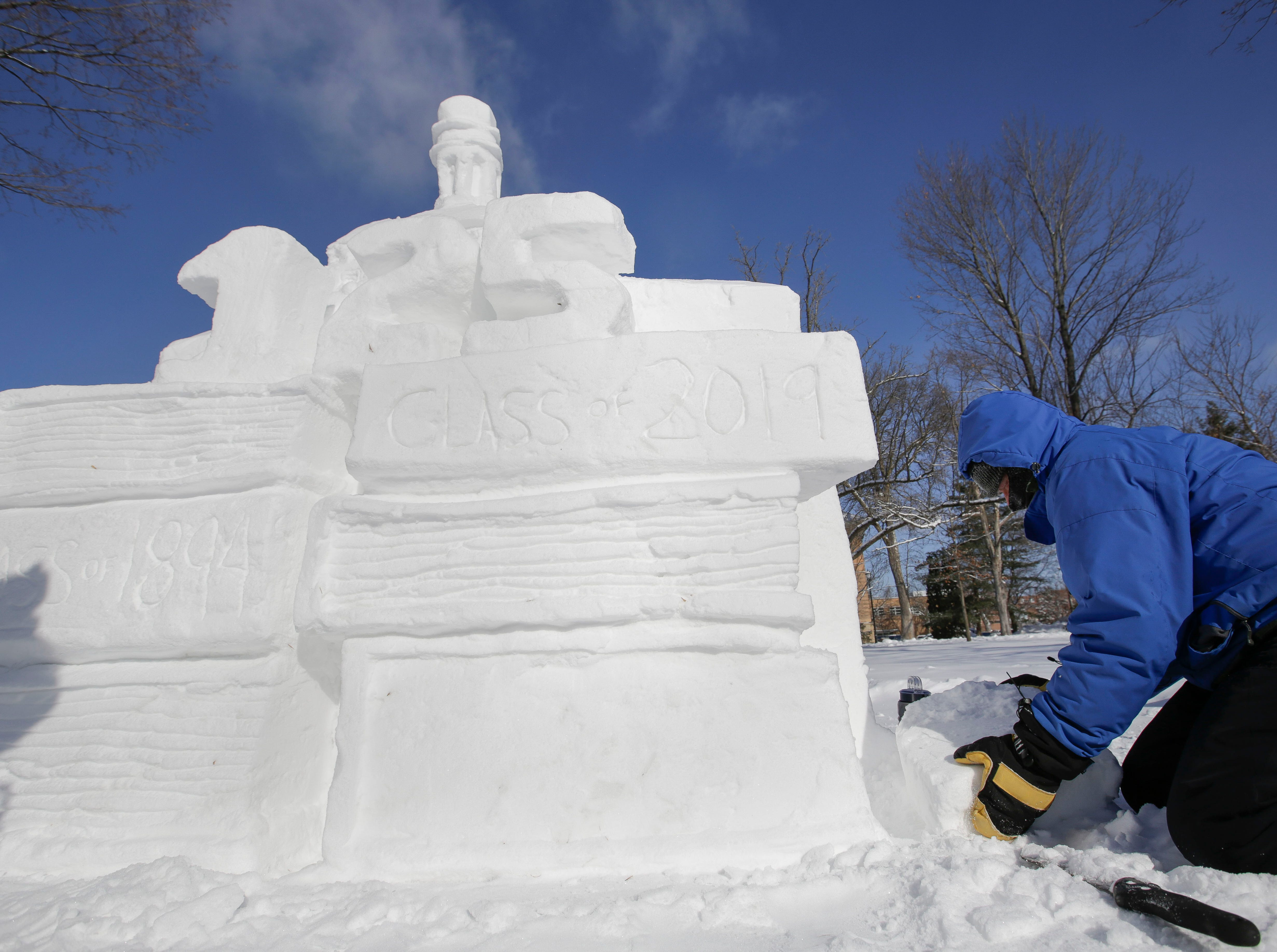 Local artist Jef Schobert works on a sculpture on Friday, February 8, 2019, on the UWSP campus in Stevens Point, Wis. The sculpture is to commemorate UWSP's 125th anniversary.Tork Mason/USA TODAY NETWORK-Wisconsin