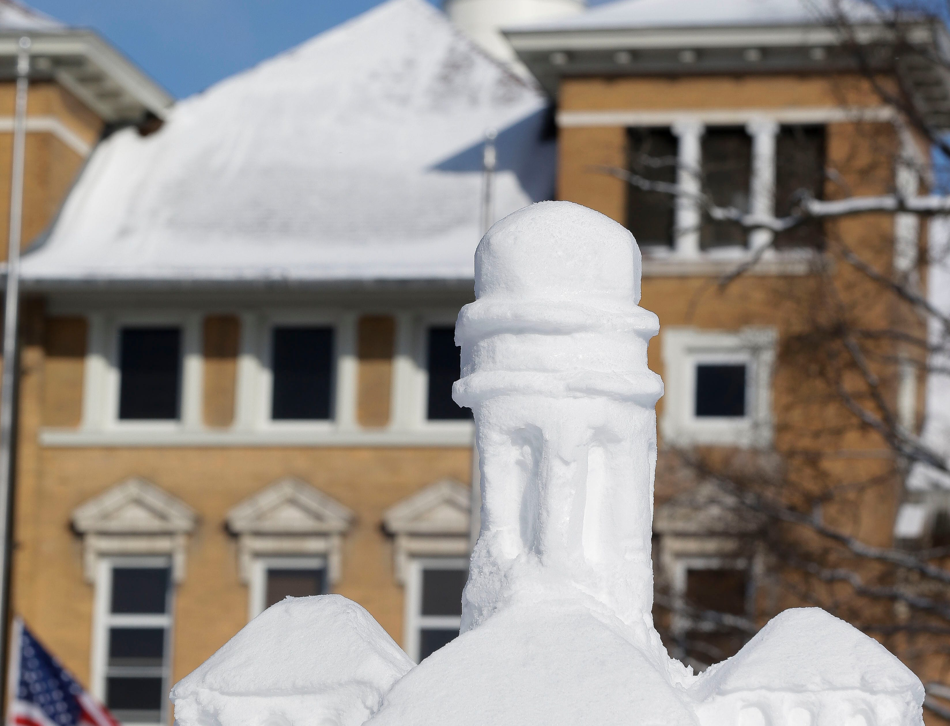 A snow sculpture of Old Main is seen on Friday, February 8, 2019, on the UWSP campus in Stevens Point, Wis. The sculpture, built by local artist Jef Schobert, is meant to commemorate UWSP's 125th anniversary.Tork Mason/USA TODAY NETWORK-Wisconsin
