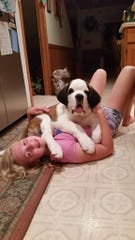 Mikala Seymour shares a moment with her Saint Bernard, Ellington, after she first brought him home as a puppy.