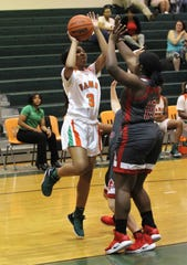 FAMU DRS junior Ashley Reddick shoots a baseline shot as FAMU DRS' girls basketball team beat NFC 59-41 for a District 1-3A title on Jan. 7, 2019.