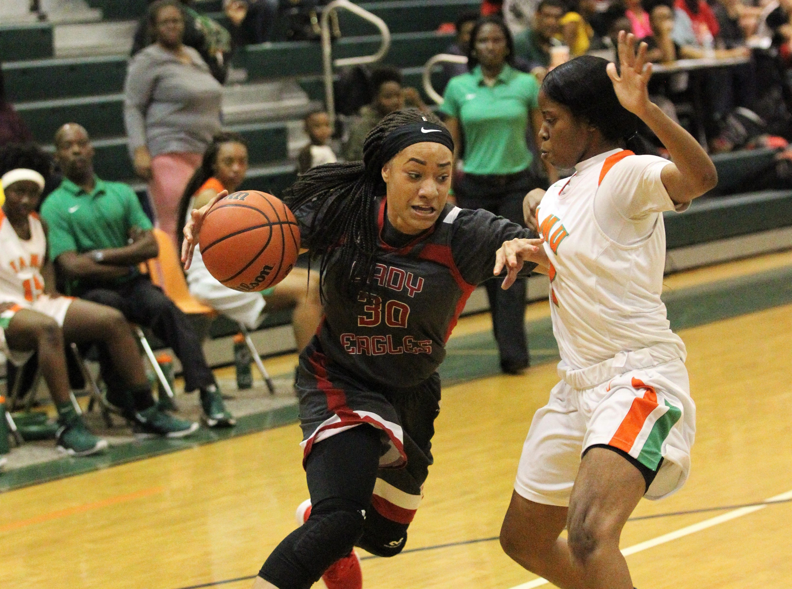 NFC senior Caylan Jones drives to the basket as FAMU DRS' girls basketball team beat NFC 59-41 for a District 1-3A title on Jan. 7, 2019.