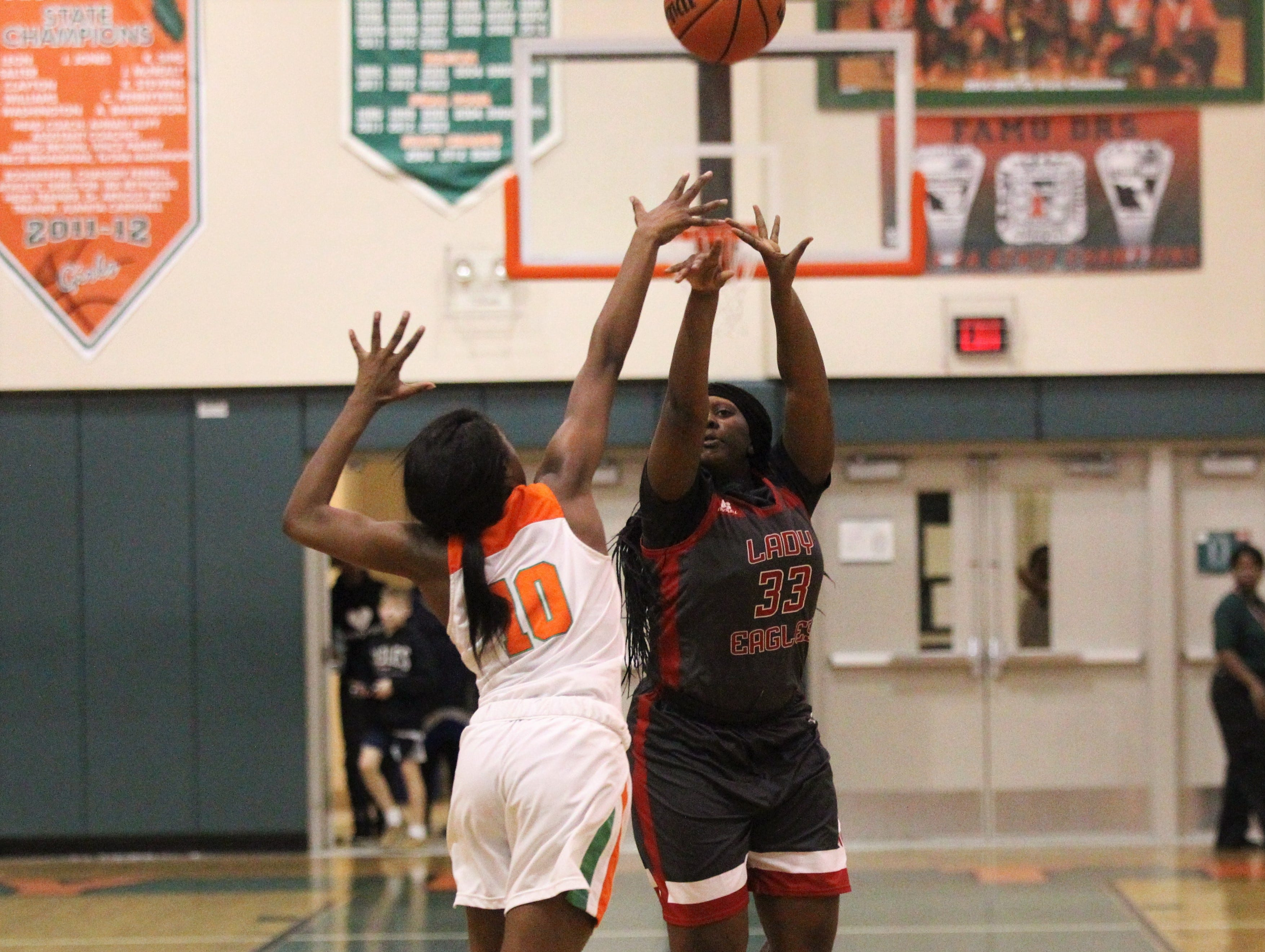 NFC sophomore Elizabeth Kever shoots a 3-pointer as FAMU DRS' girls basketball team beat NFC 59-41 for a District 1-3A title on Jan. 7, 2019.