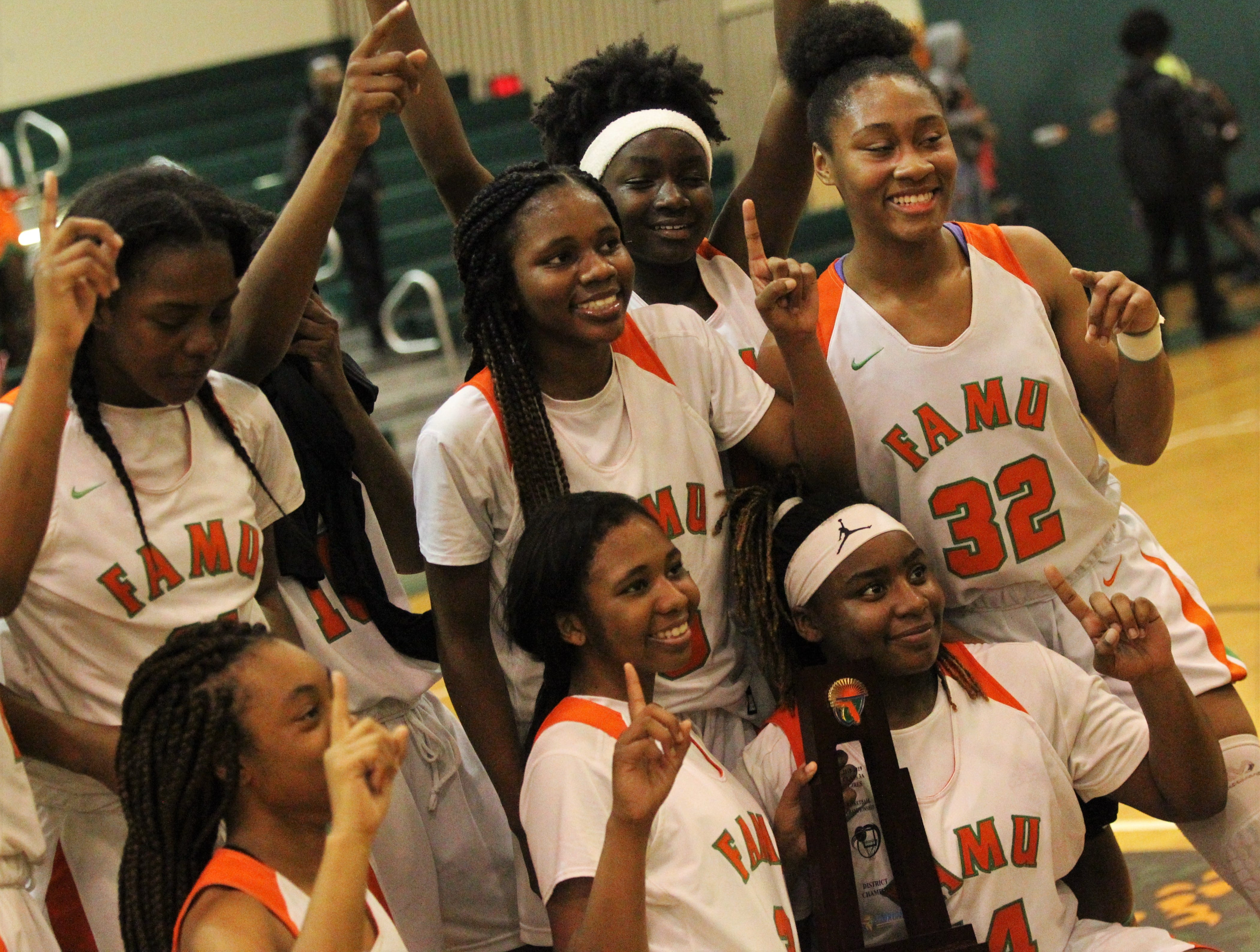 FAMU DRS' girls basketball team celebrates beating NFC 59-41 for a District 1-3A title on Jan. 7, 2019.