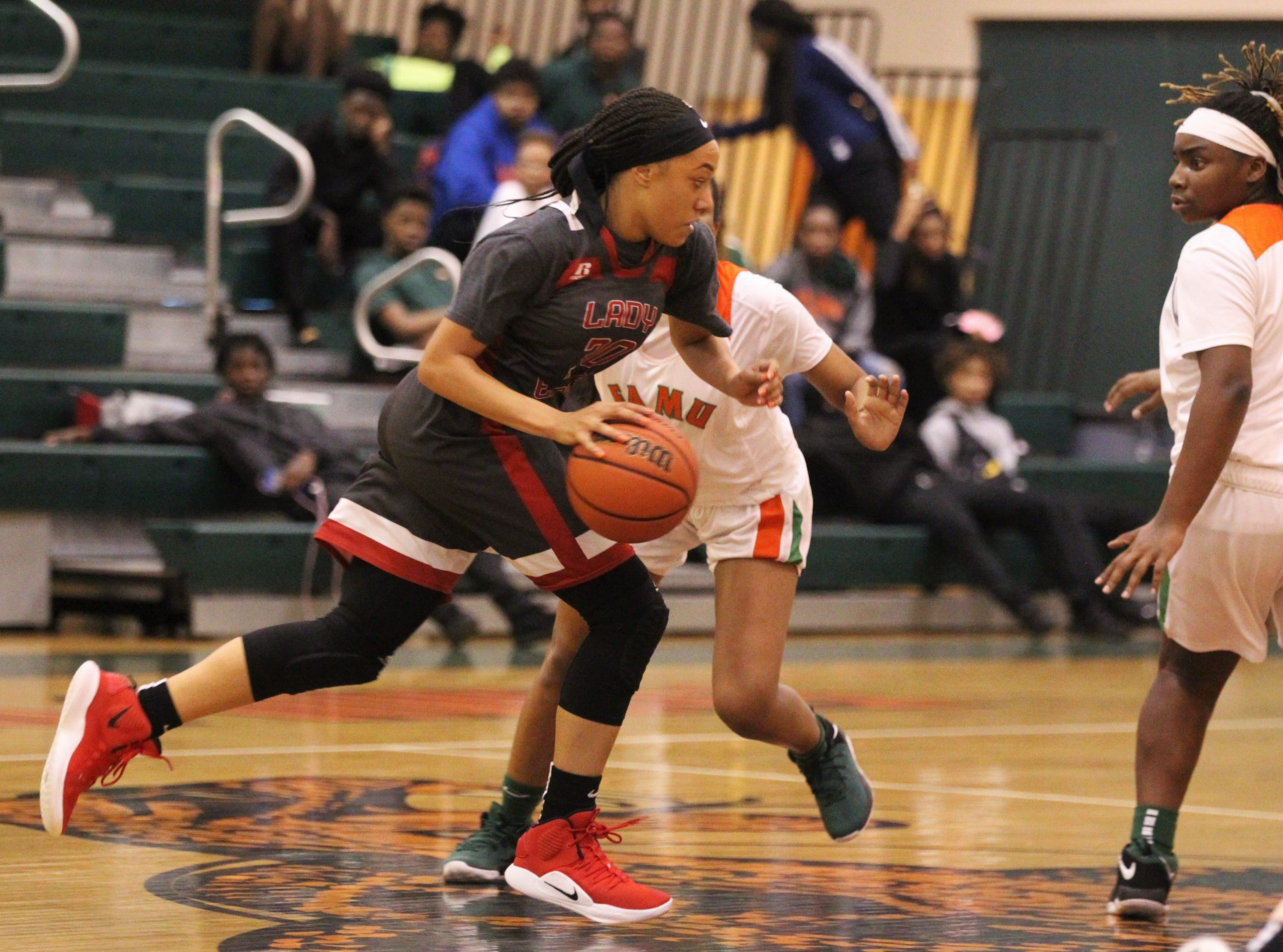 NFC senior Caylan Jones dribles up the court against press defense as FAMU DRS' girls basketball team beat NFC 59-41 for a District 1-3A title on Jan. 7, 2019.