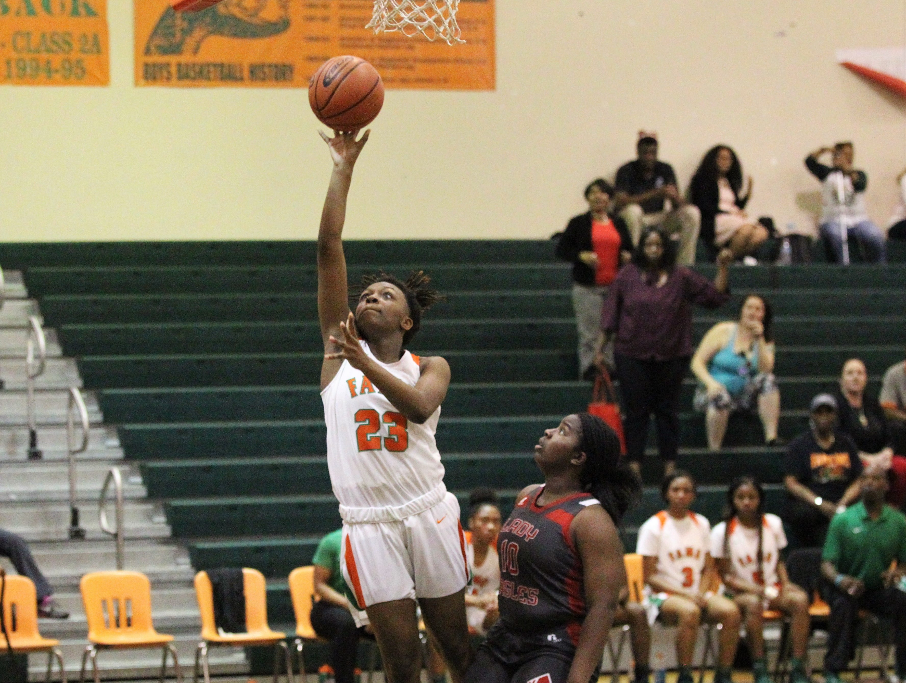 FAMU DRS senior Ayleshia Vickers goes up for a layup off a steal as FAMU DRS' girls basketball team beat NFC 59-41 for a District 1-3A title on Jan. 7, 2019.