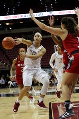 Florida State Seminoles guard Nausia Woolfolk (13) passes behind her to an open teammate as the Florida State Seminoles host the NC State Wolfpack at the Tucker Civic Center, Thursday Feb. 7, 2019.