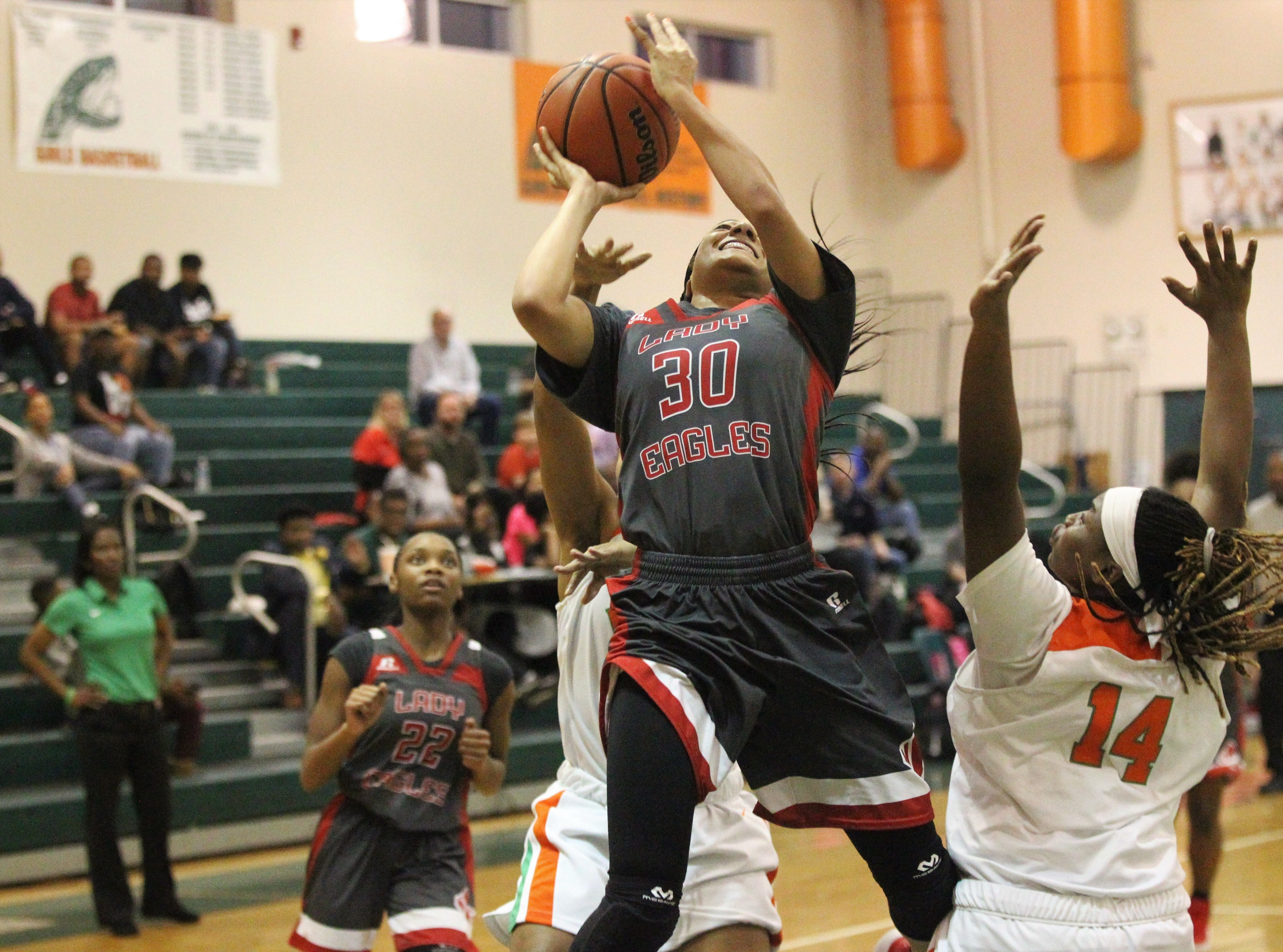 NFC senior Caylan Jones goes up for a layup in traffic as FAMU DRS' girls basketball team beat NFC 59-41 for a District 1-3A title on Jan. 7, 2019.