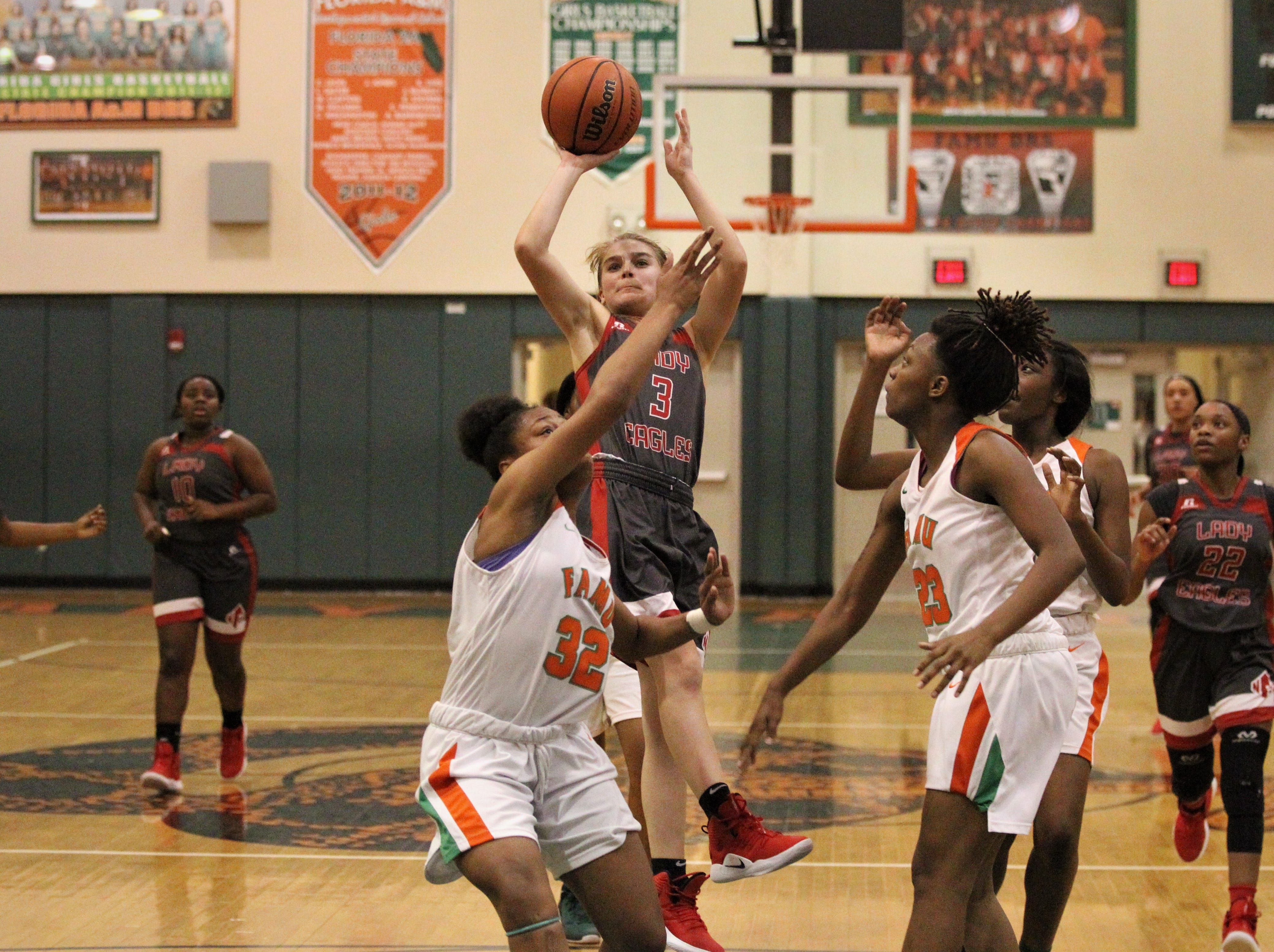 NFC freshman Emma Brice hangs in the air for a jumper as FAMU DRS' girls basketball team beat NFC 59-41 for a District 1-3A title on Jan. 7, 2019.