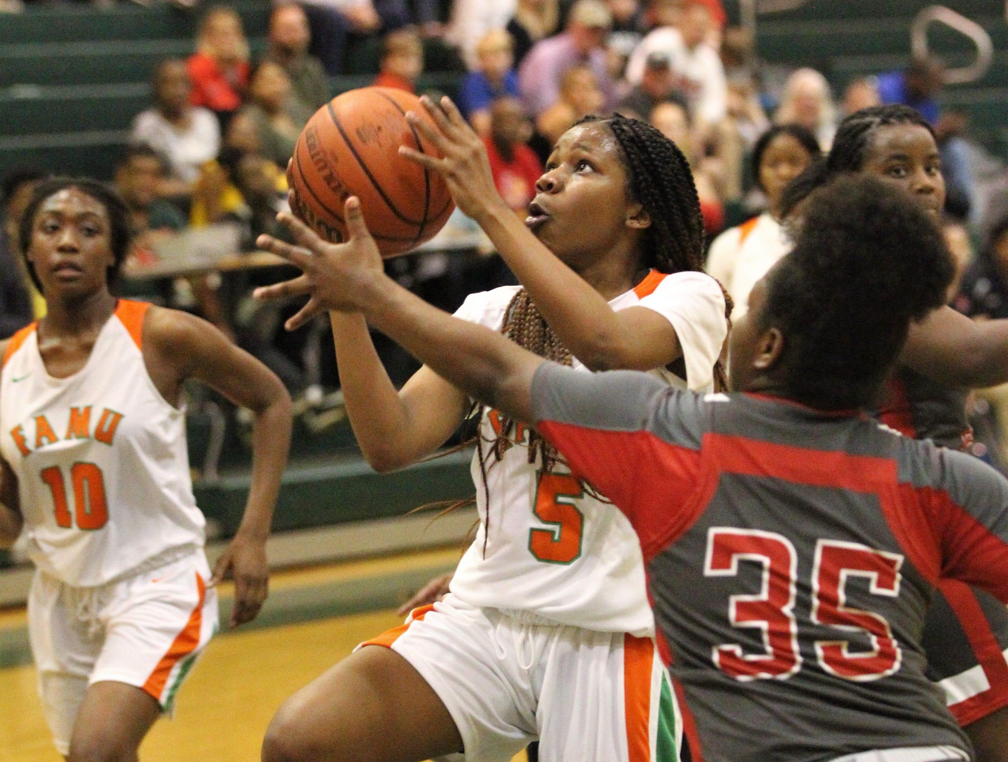 FAMU DRS freshman Alexandria Reddick drives for a layup as FAMU DRS' girls basketball team beat NFC 59-41 for a District 1-3A title on Jan. 7, 2019.
