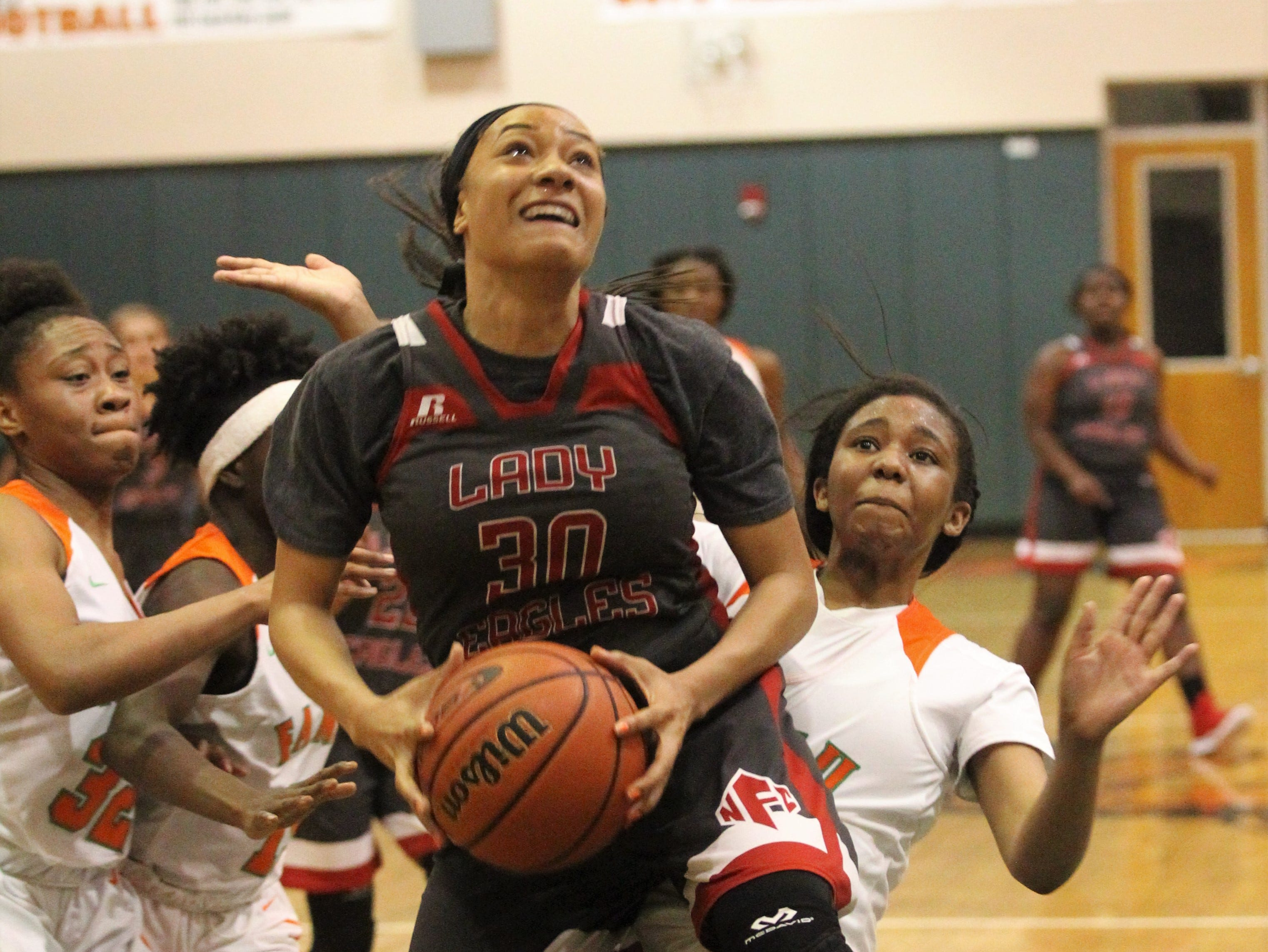 NFC senior Caylan Jones hangs in the air while attempting a layup as FAMU DRS' girls basketball team beat NFC 59-41 for a District 1-3A title on Jan. 7, 2019.
