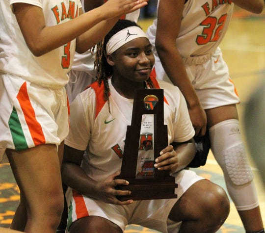 FAMU DRS freshman Ameari Logan and the Rattlers' girls basketball team celebrate beating NFC 59-41 for a District 1-3A title on Jan. 7, 2019.