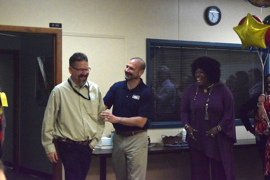 Jeremy Shaw (left) is surprised with the 2018-19 LCS School Related Employee of the Year Award.