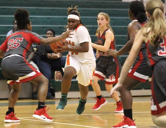 FAMU DRS freshman Ameari Logan drives to the basket as FAMU DRS' girls basketball team beat NFC 59-41 for a District 1-3A title on Jan. 7, 2019.