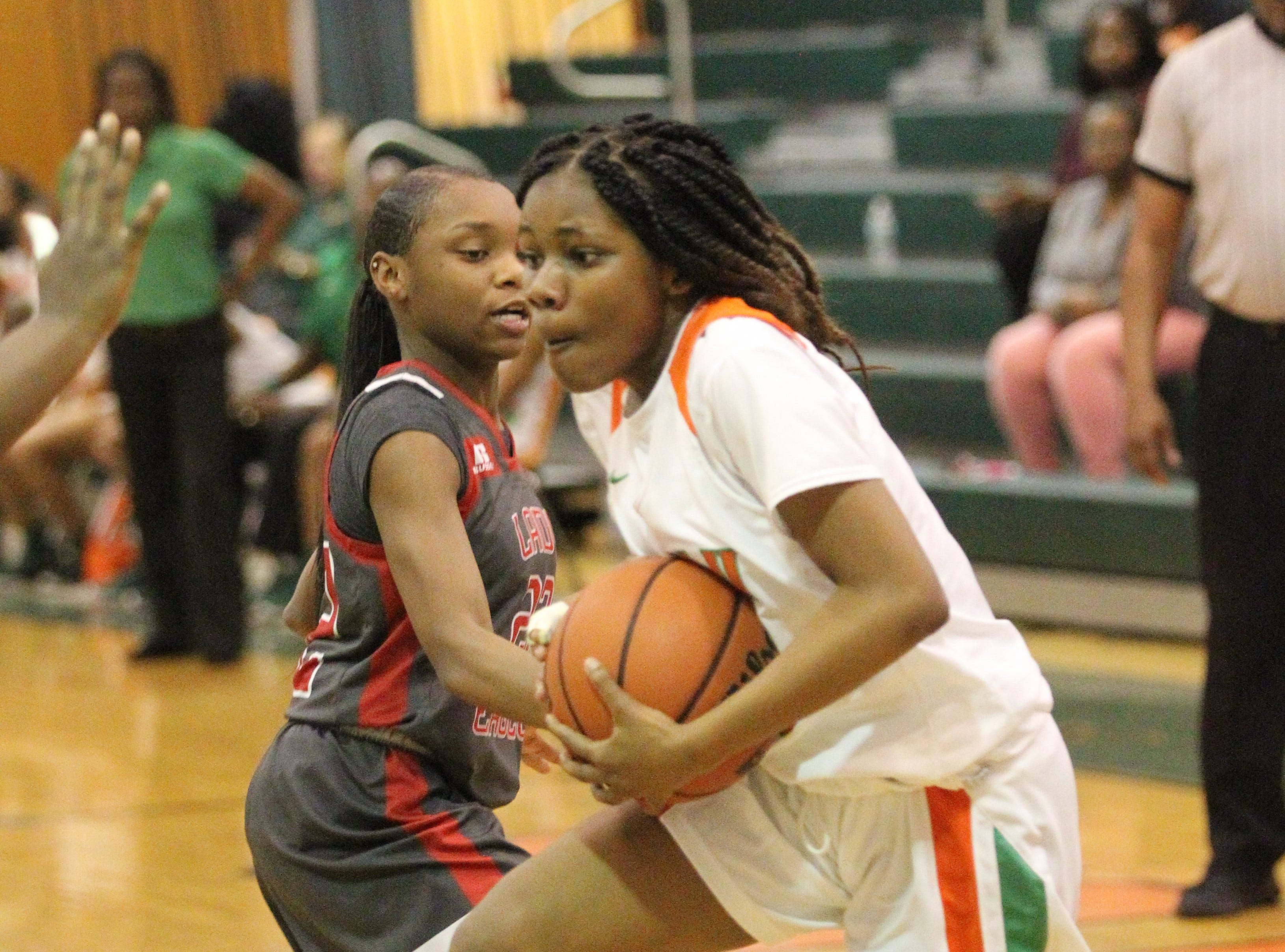 FAMU DRS freshman Alexandria Reddrick drives to the basket as FAMU DRS' girls basketball team beat NFC 59-41 for a District 1-3A title on Jan. 7, 2019.