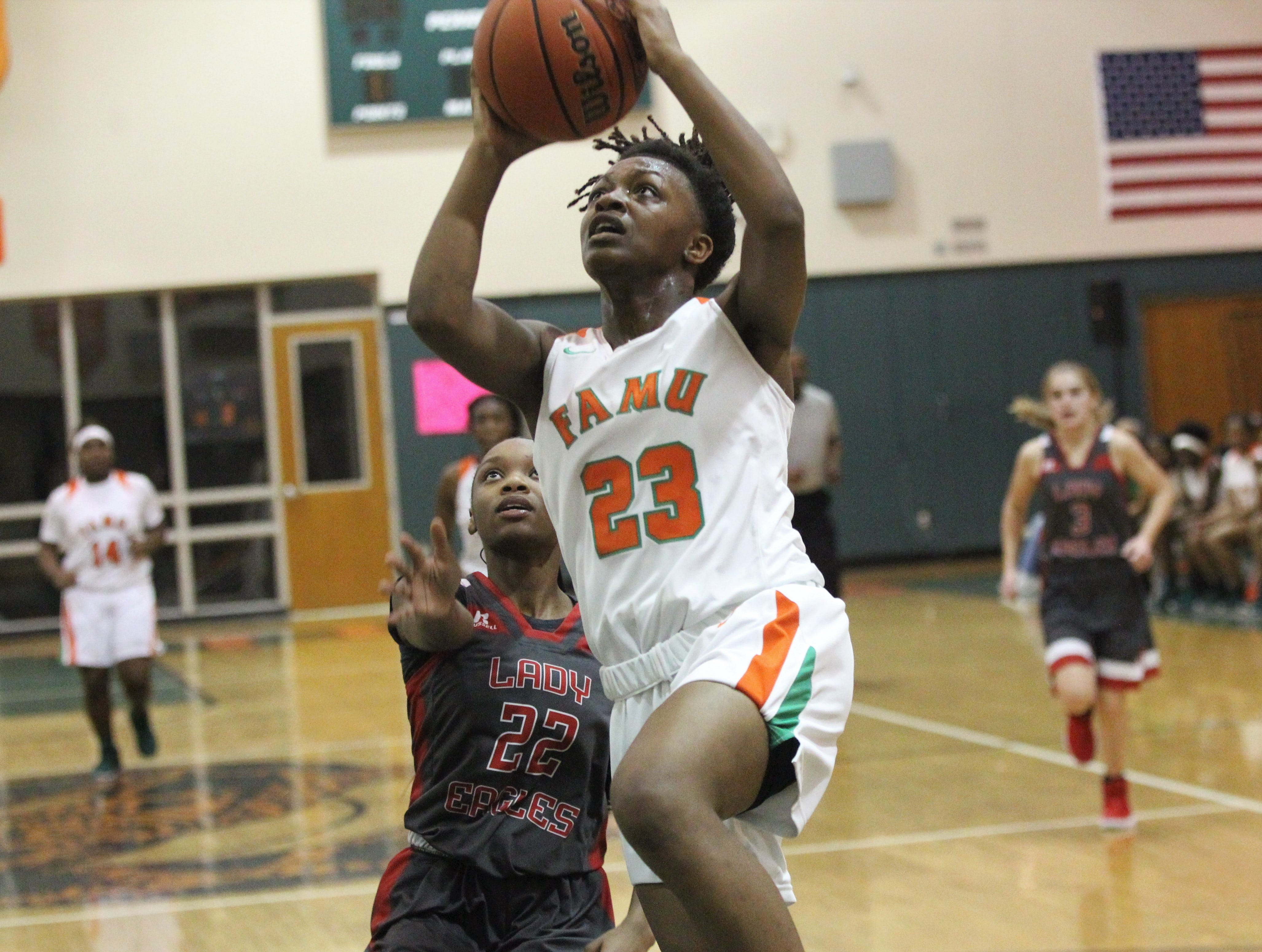 FAMU DRS senior Ayleshia Vickers goes up for a layup as FAMU DRS' girls basketball team beat NFC 59-41 for a District 1-3A title on Jan. 7, 2019.