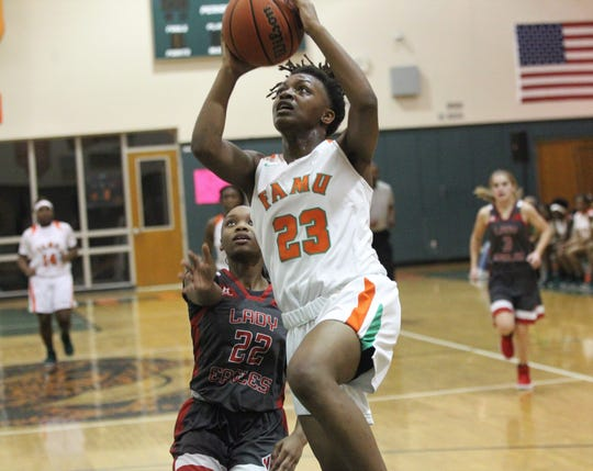 FAMU DRS senior Aylesia Vickers goes up for a layup as FAMU DRS' girls basketball team beat NFC 59-41 for a District 1-3A title on Jan. 7, 2019.