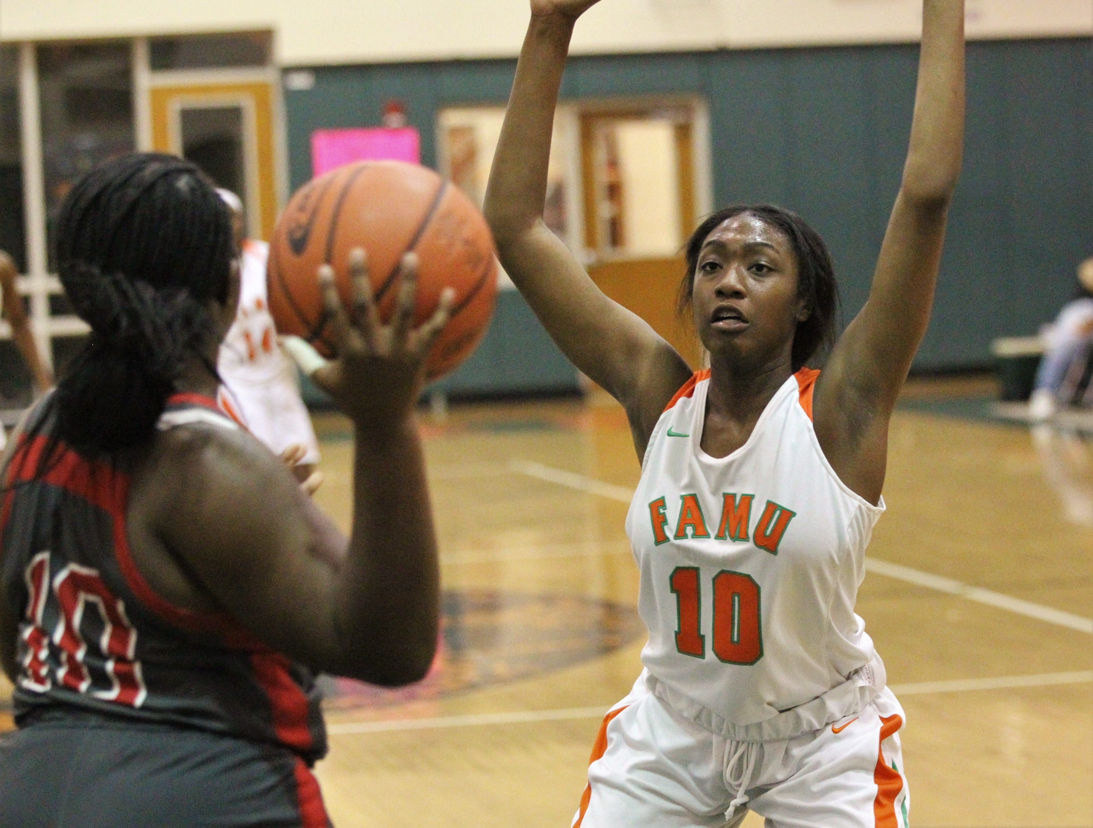 FAMU DRS junior LaTessa Taylor guards an inbounds pass as FAMU DRS' girls basketball team beat NFC 59-41 for a District 1-3A title on Jan. 7, 2019.