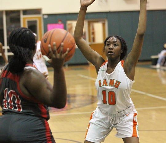 FAMU DRS junior LaTeesa Taylor guards an inbounds pass as FAMU DRS' girls basketball team beat NFC 59-41 for a District 1-3A title on Jan. 7, 2019.