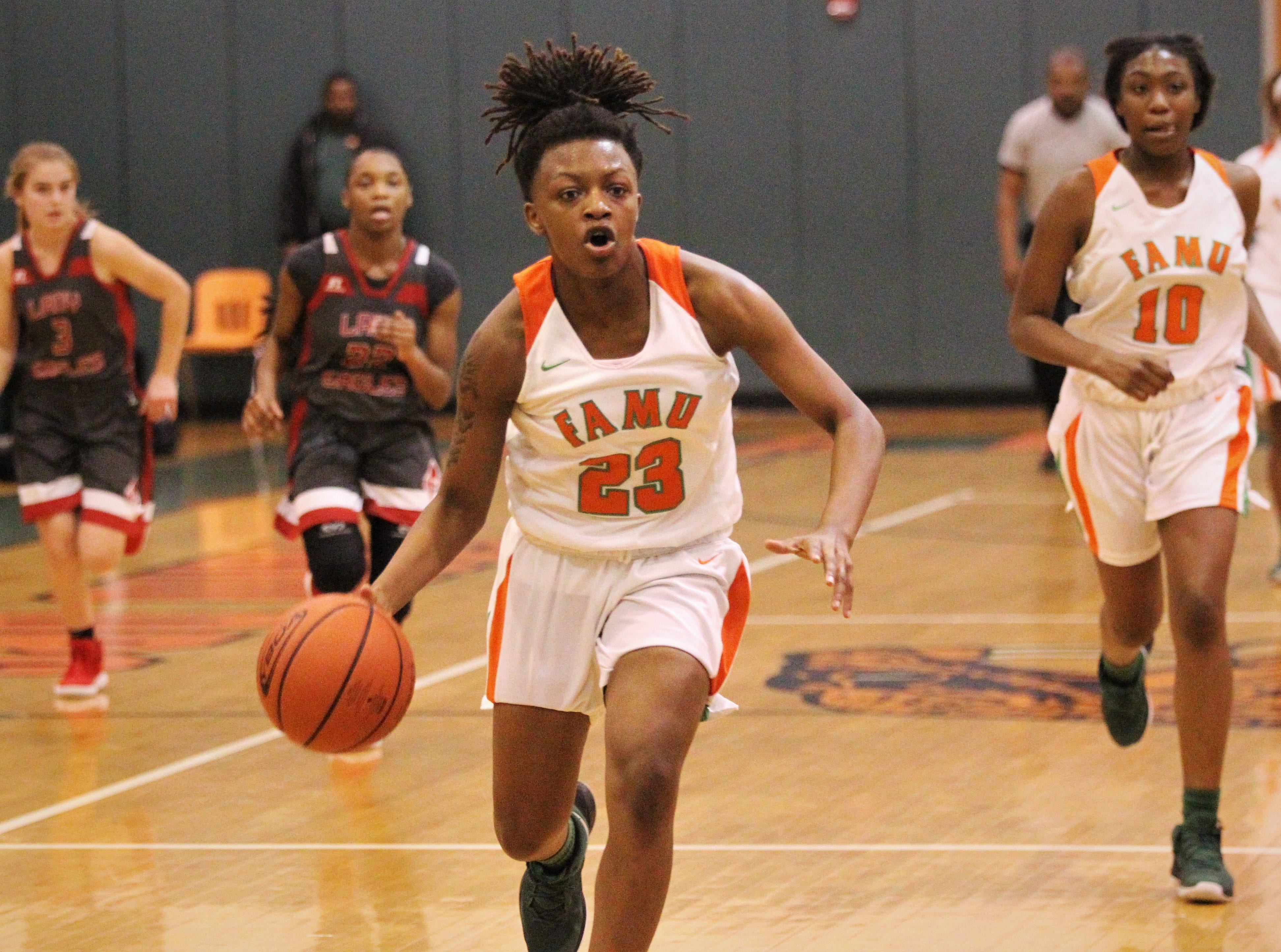 FAMU DRS senior Ayleshia VIckers runs up court on a fastbreak as FAMU DRS' girls basketball team beat NFC 59-41 for a District 1-3A title on Jan. 7, 2019.