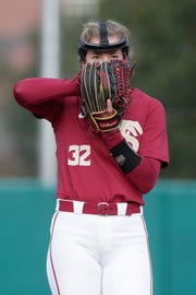 Florida State Seminoles pitcher Kathryn Sandercock (32) looks for the signal for what pitch to throw as The Florida State Seminoles host the UNC Wilmington Seahawks in their first game of the season at the Joanne Graf Stadium Friday, Feb. 8, 2019.