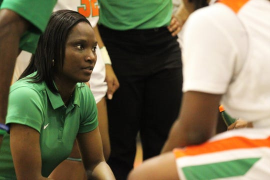 FAMU DRS girls basketball coach Ericka Cromartie talks to her team during a timeout as the Rattlers beat NFC 59-41 for a District 1-3A title on Jan. 7, 2019.