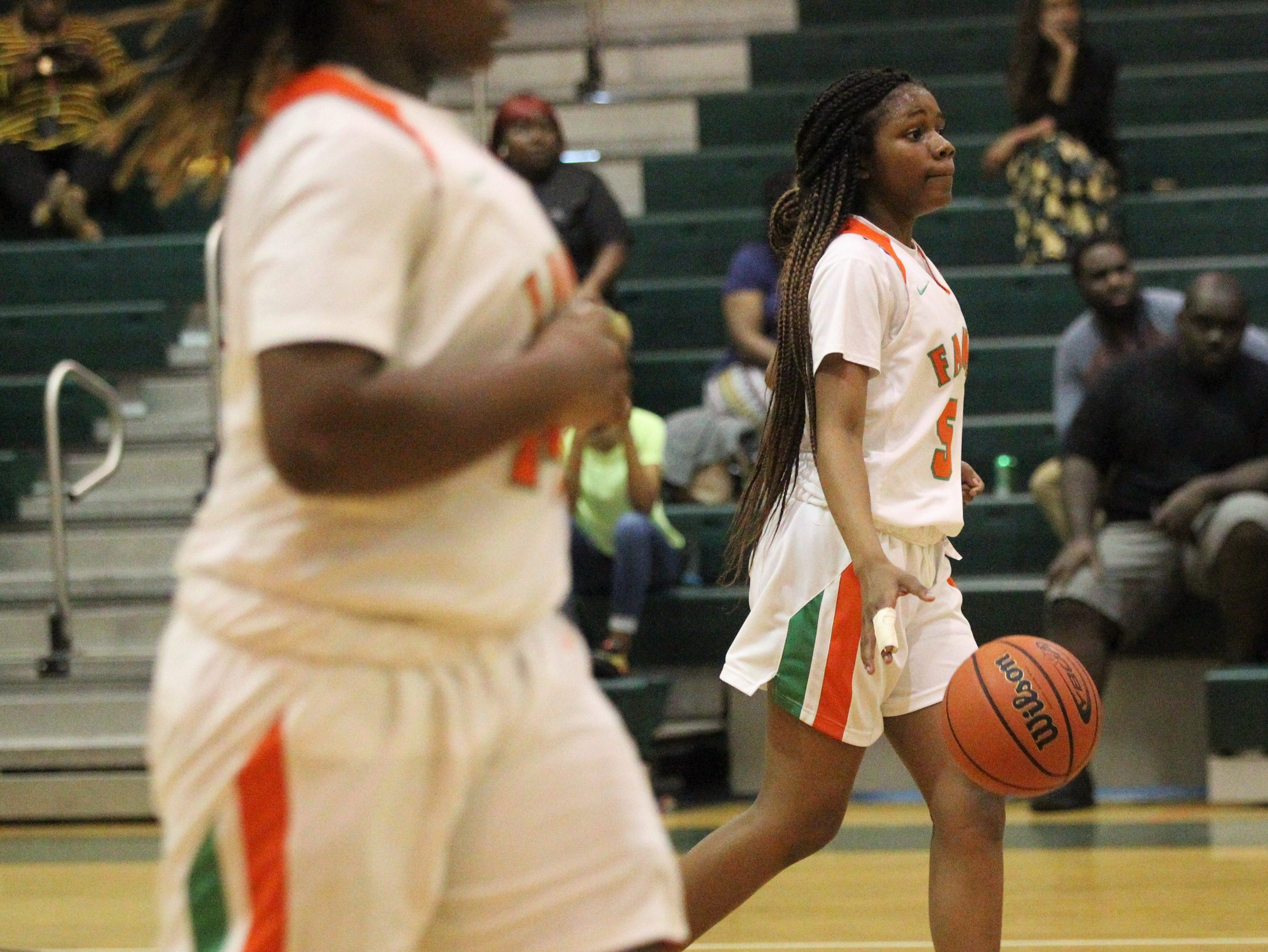 FAMU DRS freshman Alexandria Reddick brings the ball up the court as FAMU DRS' girls basketball team beat NFC 59-41 for a District 1-3A title on Jan. 7, 2019.