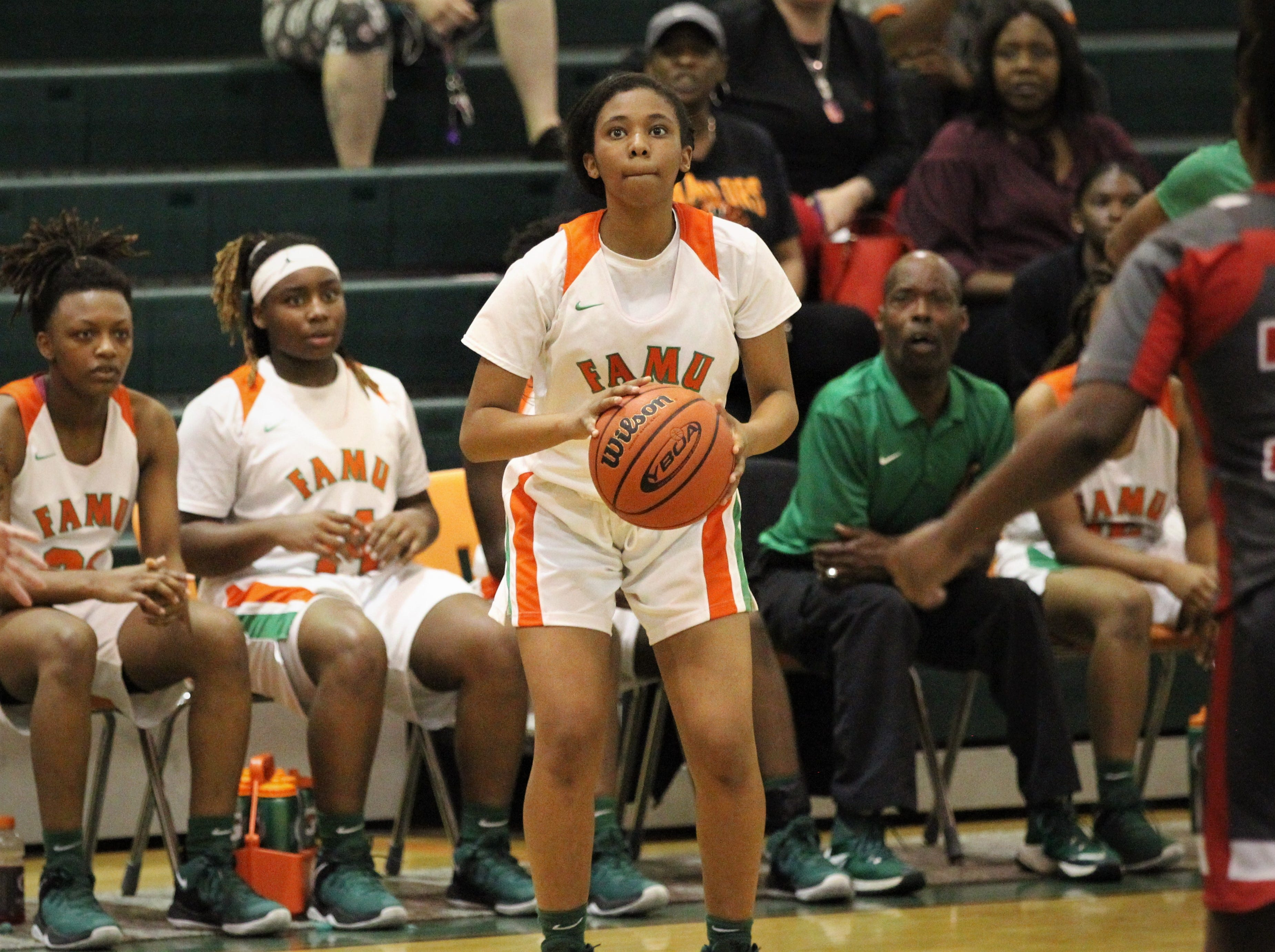 FAMU DRS junior Ashley Reddick sets up for a 3-pointer as FAMU DRS' girls basketball team beat NFC 59-41 for a District 1-3A title on Jan. 7, 2019.