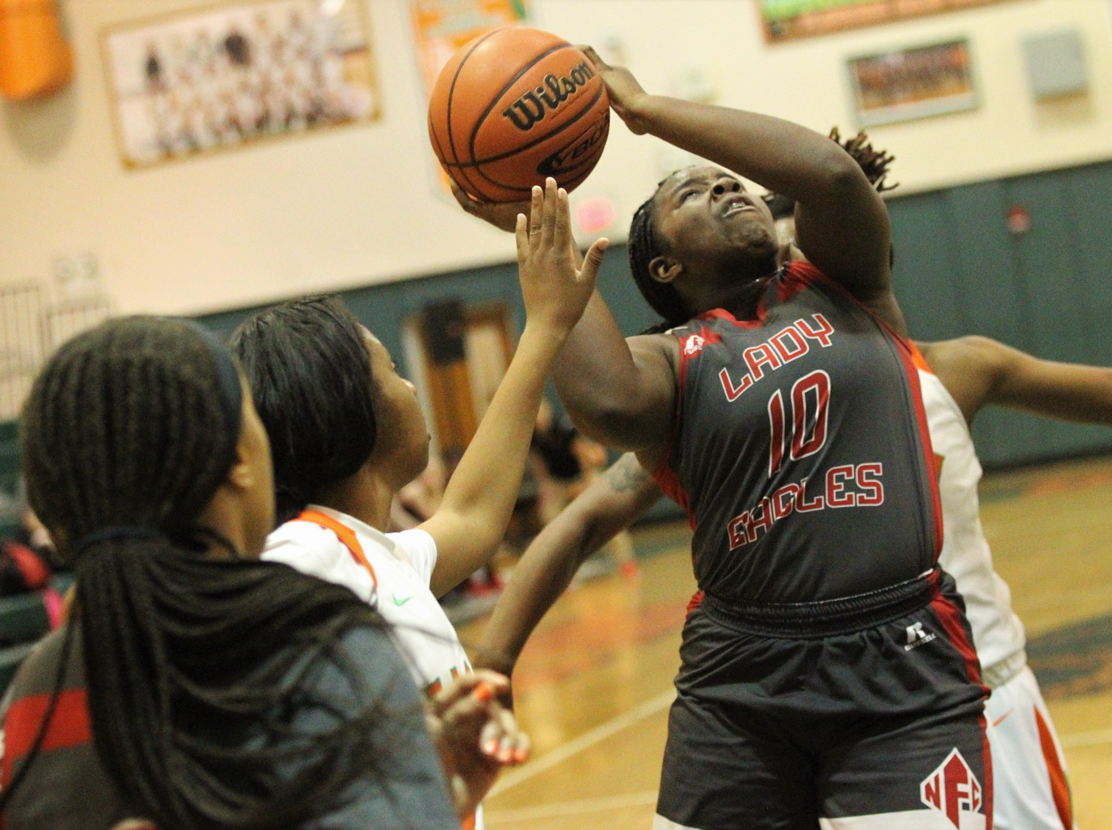 NFC sophomore Eva Holmes tries to get a shot off in traffic as FAMU DRS' girls basketball team beat NFC 59-41 for a District 1-3A title on Jan. 7, 2019.