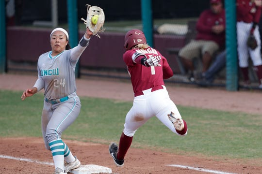 Florida State Seminoles infielder Dani Morgan (1) is out after being tagged at first by UNC Wilmington Seahawks infielder Dominique Travers (24). The Florida State Seminoles host the UNC Wilmington Seahawks in their first game of the season at the Joanne Graf Stadium, Friday Feb. 8, 2019.