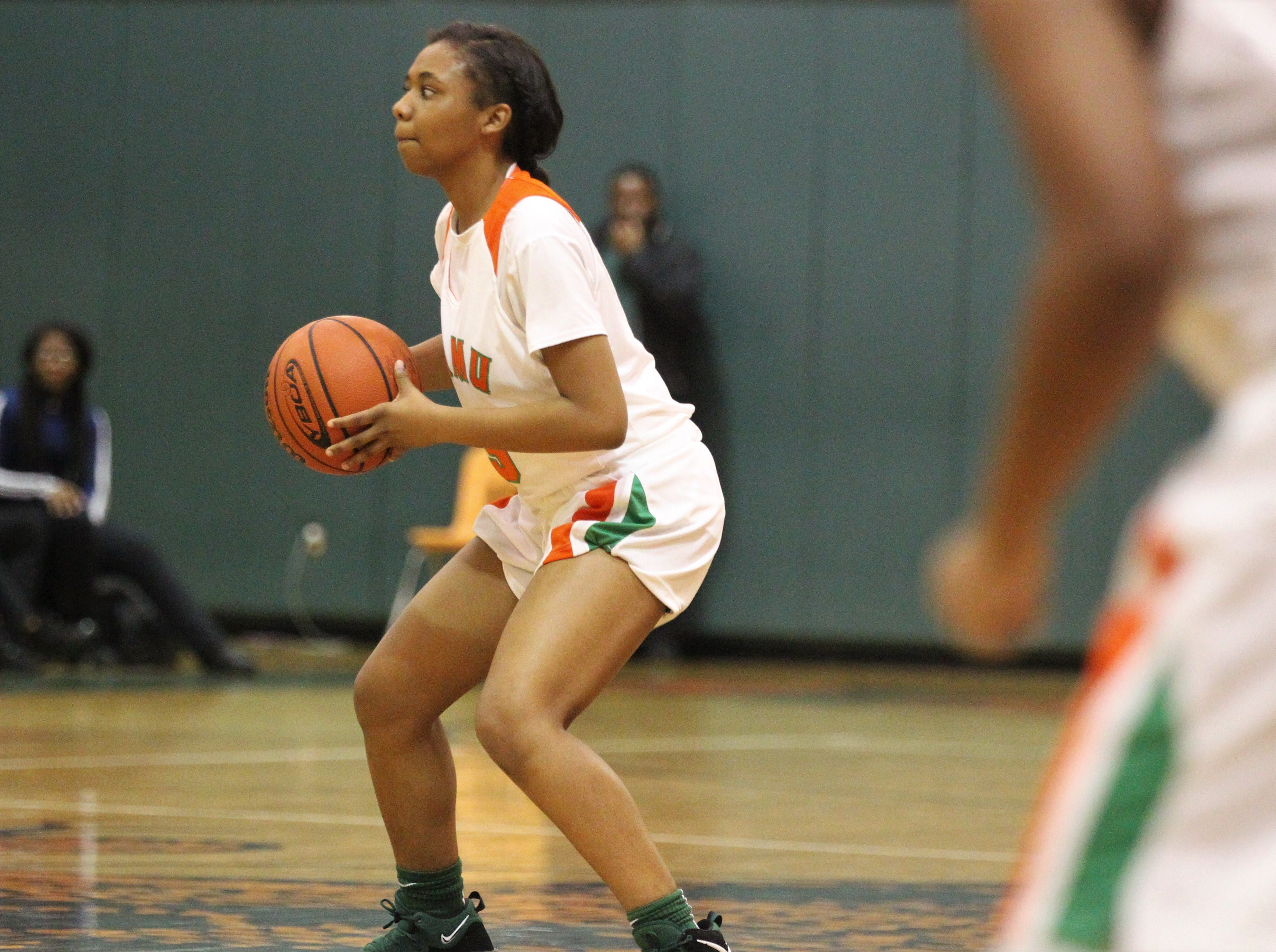FAMU DRS junior Ashley Reddick looks for a pass as FAMU DRS' girls basketball team beat NFC 59-41 for a District 1-3A title on Jan. 7, 2019.