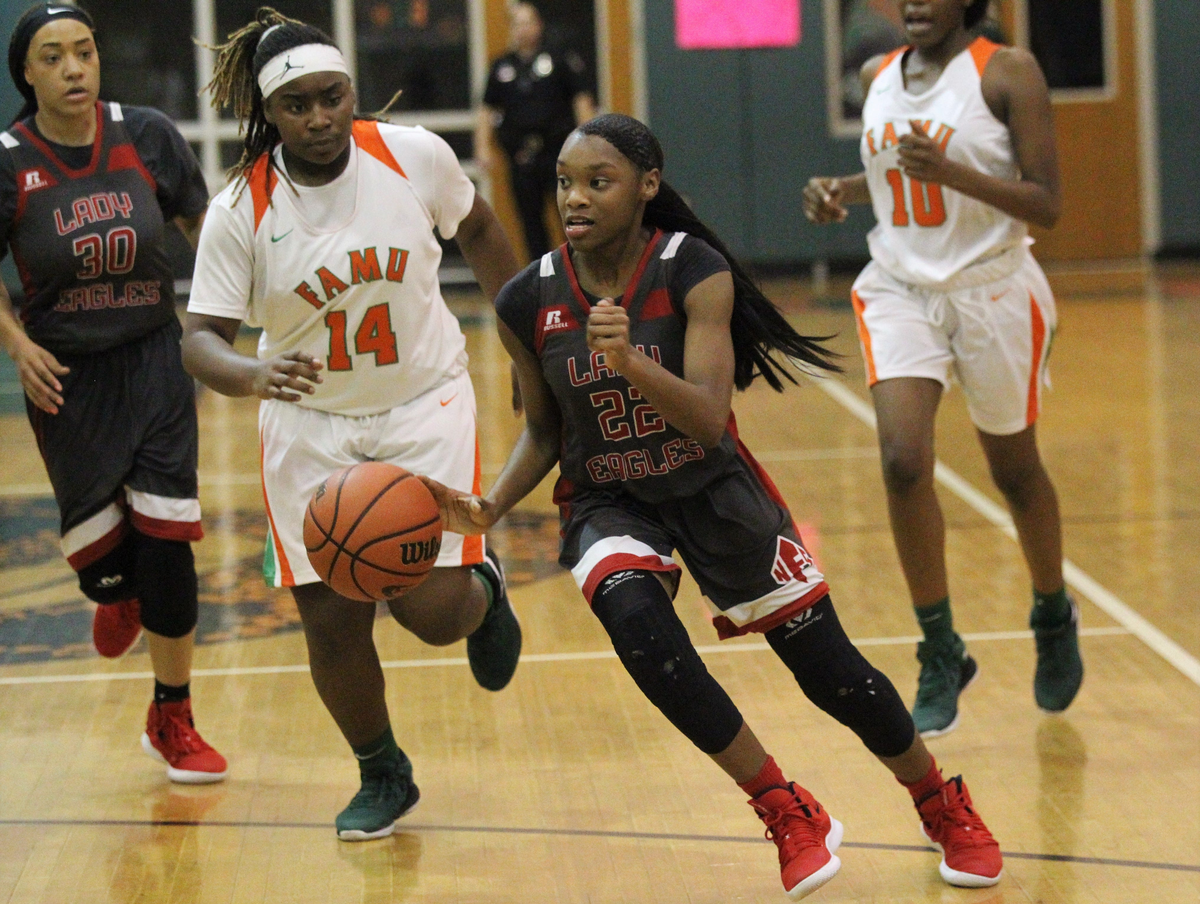 NFC junior Alexsis Thomas dribbles up the court as FAMU DRS' girls basketball team beat NFC 59-41 for a District 1-3A title on Jan. 7, 2019.