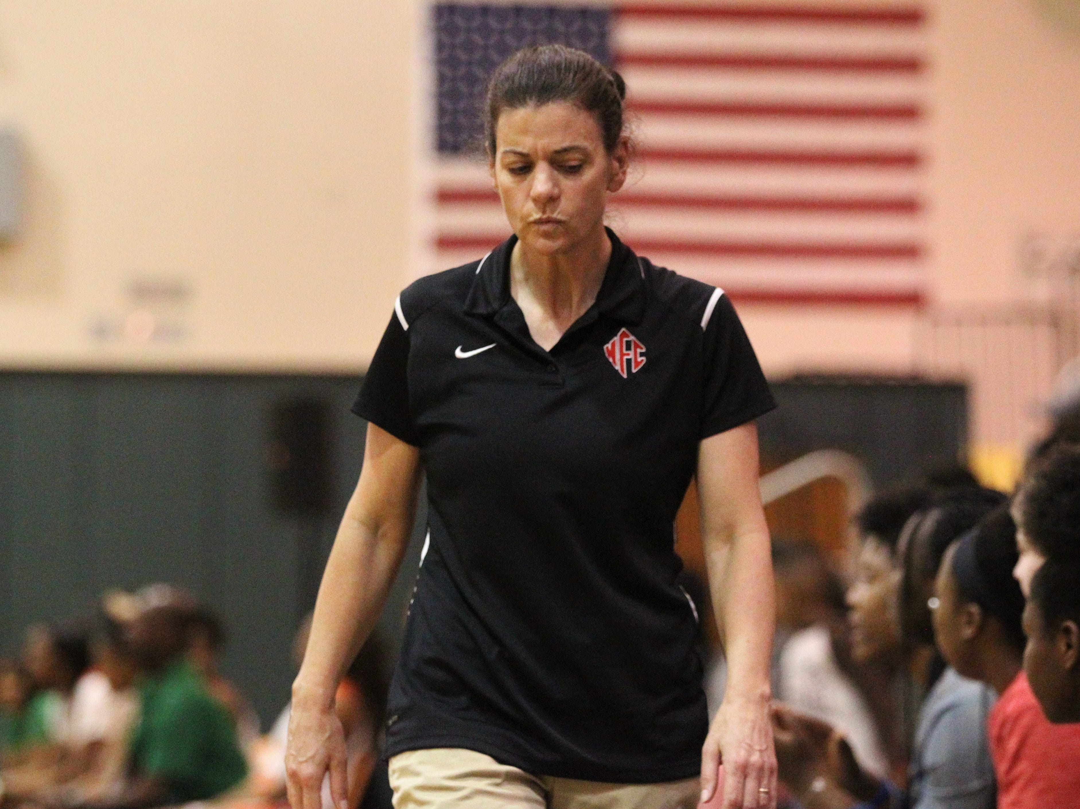 NFC girls basketball coach Jodie Price walks her sideline as FAMU DRS beat NFC 59-41 for a District 1-3A title on Jan. 7, 2019.